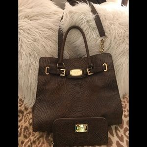 Michael Kors leather purse with matching wallet